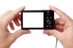 digitala händer för kamera som rymmer fotoet Arkivbilder