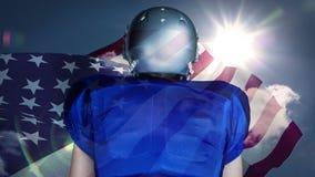 Digitale animatie die van rugbyspeler zich tegen Amerikaanse vlag bevinden stock video