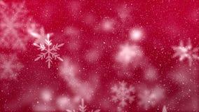 Digitale animatie die van sneeuwvlok zich tegen de rode achtergrond bewegen stock video
