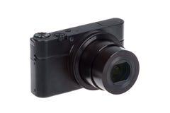 Digitale compacte camera met open geïsoleerde lens Stock Foto