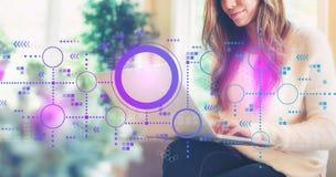 Digitale grafieken en hexagon netten met vrouw die laptop met behulp van royalty-vrije stock afbeeldingen