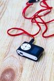 Digitale media speler en hoofdtelefoons Stock Foto's