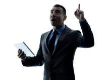Digitale Tablette des Geschäftsmannes lokalisiert Stockbild