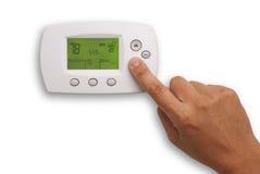 Digitale Thermostaat en mannelijke hand Royalty-vrije Stock Foto's