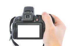 Digitalkamera in einer Hand Lizenzfreie Stockbilder