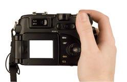 Digitalkamerafoto in einer Hand Stockbild