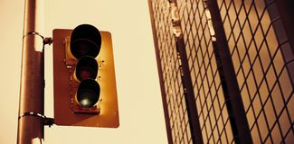 Traffic light with office in the background. Digitally altered view of modern office building stock images
