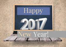 Digitally composite image 3D of 2017 new year on blackboard. Against wooden background Stock Photos