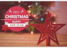 Digitally composite image of merry christmas and happy new year wishes Stock Photo