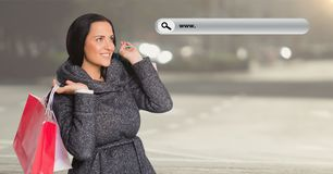 Digitally composite image of woman holding shopping bag and a search bar Stock Photo
