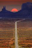 Digitally created image of a roadway leading to Monument Valley Stock Images