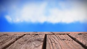 Wooden deck and sky. Digitally generated animation of clouds moving in the sky with a view of a wooden deck stock video footage
