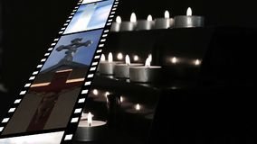 Film strip and candles. Digitally generated animation of film strip showing different videos and pictures about religion while candles are lit and blown at the stock video