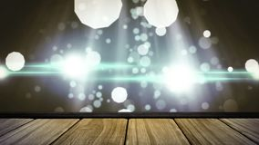 Bokeh and flashing lights. Digitally generated animation of wooden deck while bokeh floats in the background and white light flashes at the middle of the screen stock footage