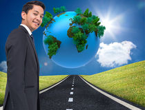 Digitally generated earth floating over street Royalty Free Stock Images