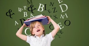 Digitally generated image of boy carrying book on head with letters flying against green background. Digital composite of Digitally generated image of boy Royalty Free Stock Photography