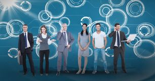 Digitally generated image of business people standing against tech graphics. Digital composite of Digitally generated image of business people standing against Royalty Free Stock Image