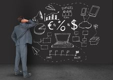 Digitally generated image of business professional looking at the blackboard stock photography