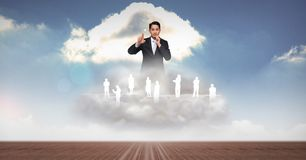 Digitally generated image of businessman with employees on clouds. Digital composite of Digitally generated image of businessman with employees on clouds Stock Image