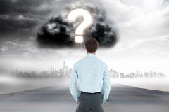 Digitally generated image of businessman looking at question mark in cloudy sky over city. Digital composite of Digitally generated image of businessman looking Royalty Free Stock Photography