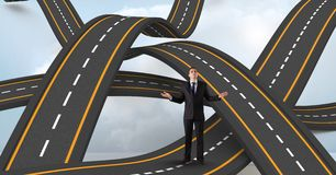Digitally generated image of businessman standing on wavy road in sky. Digital composite of Digitally generated image of businessman standing on wavy road in sky Royalty Free Stock Photos