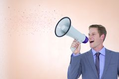 Digitally generated image of businessman talking on megaphone emitting various shapes. Digital composite of Digitally generated image of businessman talking on Stock Images