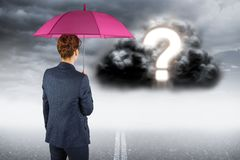 Digitally generated image of businesswoman with umbrella looking at question mark on cloud. Digital composite of Digitally generated image of businesswoman with Royalty Free Stock Images