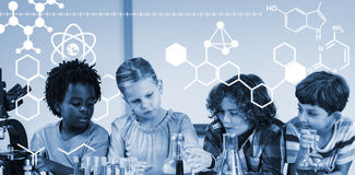 Composite image of digitally generated image of chemical structure. Digitally generated image of chemical structure against kids doing a chemical experiment in Royalty Free Stock Images