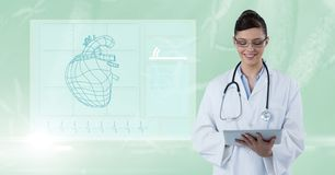 Digitally generated image of female doctor using digital tablet by diagram against green background Stock Image