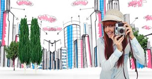 Digitally generated image of female tourist holding camera with buildings in background Stock Photography