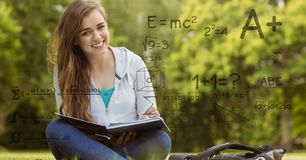 Digitally generated image of formulas with female college student in background Stock Photos