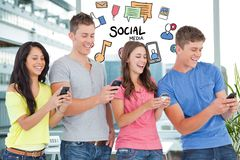 Digitally generated image of friends using smart phone with various icons flying agiant building stock photos