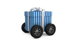 Digitally generated image of gift box with wheels Stock Photos