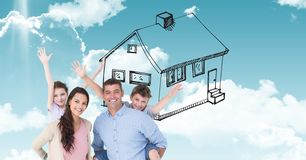 Digitally generated image of happy family with house drawn in  sky Royalty Free Stock Photography