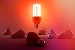 Digitally generated image of illuminated energy efficient lightbulb over bulbs. On gray background royalty free illustration