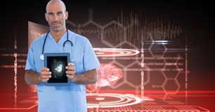 Digitally generated image of male doctor showing digital tablet against tech graphics. Digital composite of Digitally generated image of male doctor showing stock photography
