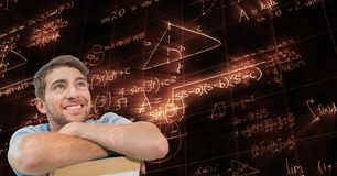Digitally generated image of man looking at glowing mathematical equations Royalty Free Stock Images