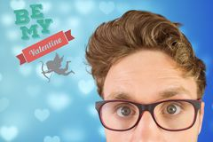 Digitally generated image of nerd man and valentine message. Against blue background Stock Images
