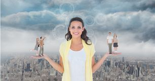 Digitally generated image of people standing on standing on woman palm against city. Digital composite of Digitally generated image of people standing on Stock Photo
