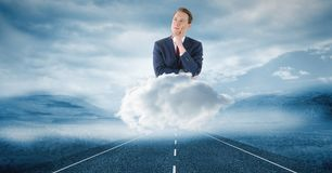 Digitally generated image of thoughtful businessman on cloud over road in sky. Digital composite of Digitally generated image of thoughtful businessman on cloud Stock Photo