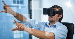 Digitally generated image of various icons with businessman using VR glasses in office. Digital composite of Digitally generated image of various icons with Stock Image