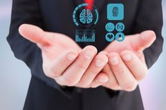 Digitally generated image of various icons on hand of businessman. Digital composite of Digitally generated image of various icons on hand of businessman stock image