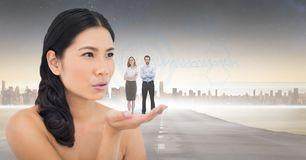 Digitally generated image of woman with business people standing on palm against city. Digital composite of Digitally generated image of women with business Stock Images