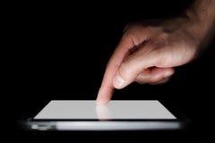 digitalt finger som pekar tableten royaltyfri fotografi