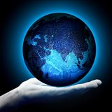 Digitized earth on the male palm royalty free stock photography