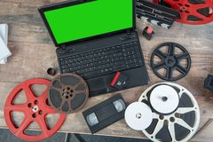 Digitizing old 16 mm film with laptop. Digitizing old 16 mm film with a laptop stock photos