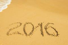 Digits auf dem Sand Stockbild
