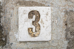 The digits with concrete on the sidewalk 3 Royalty Free Stock Photos