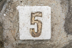 The digits with concrete on the sidewalk 5 Stock Photos