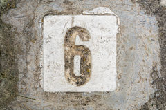 The digits with concrete on the sidewalk 6 Royalty Free Stock Photos